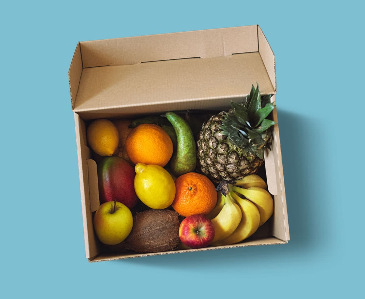 Fresh Fruit Delivery Box On Blue Background